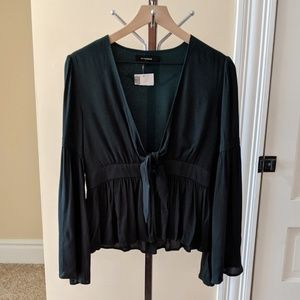 Olivaceous bell sleeve top.